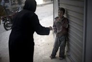 A frightened child stands in the street after a Syrian government artillery shell destroyed his family home in the Shaar neighborhood of the northern city of Aleppo on October 13. Syria banned Turkish flights from its airspace on Sunday and Turkey made a similar tit-for-tat move, as regime forces pressed their counter-attack against rebels to regain territory lost in northern battlegrounds