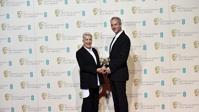 Damian Martin and Leslie Vanderwalt pose after winning the award for best hair and make-up  at the British Academy of Film and Television Arts (BAFTA) Awards at the Royal Opera House in London