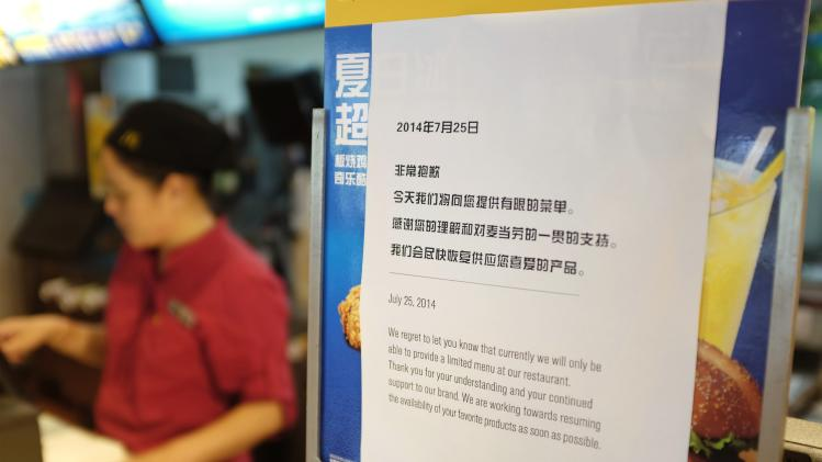 A notice informing customers that only a limited menu is available is seen at a McDonald's store in Beijing
