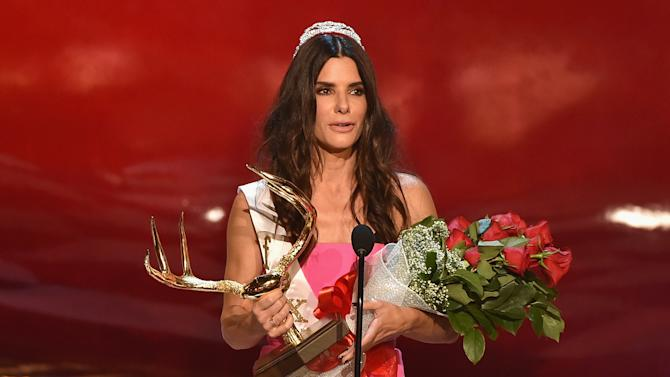 """Actress Sandra Bullock accepts the Decade of Hotness award onstage during Spike TV's """"Guys Choice 2014"""" at Sony Pictures Studios on June 7, 2014 in Culver City, California"""