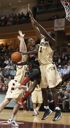 No. 5 Louisville uses defense to defeat Charleston