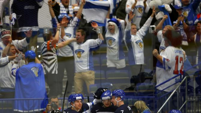 Finland's Barkov celebrates his goal against Denmark with team mates during their Ice Hockey World Championship game at the CEZ arena in Ostrava
