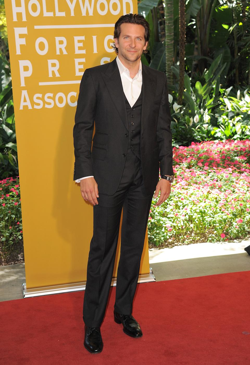 Bradley Cooper attends the Hollywood Foreign Press Association luncheon at the Beverly Hills Hotel on Thursday, Aug. 9, 2012, in Beverly Hills, Calif. (Photo by Jordan Strauss/Invision/AP)