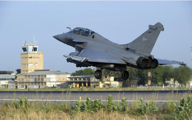 This Sunday Jan.13, 2013 photo provided by the French Army Monday Jan.14, 2013 shows a  French Rafale jetfighter landing after a mission to Mali in N'Djamena, Chad. French fighter jets bombed rebel ta