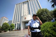 Security guards stand outside the Intermediate People's Court in Hefei, Anhui province on August 7. China appears to be preparing the public for sparing from execution the wife of politician Bo Xilai who is accused of murdering a British man, a legal expert said Sunday, as a verdict is awaited in the politically-charged case