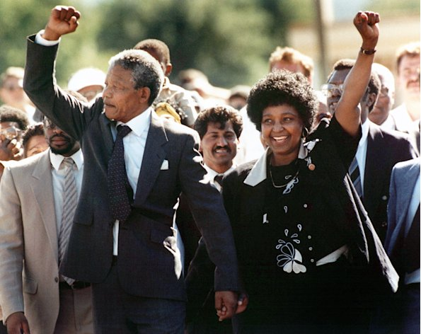 Mandela raises his fist after his release from prison in 1990 (PA)