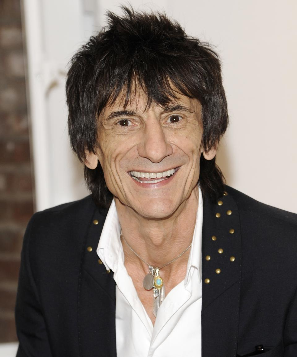 "Rolling Stones guitarist Ronnie Wood appears during a news conference unveiling his new art exhibit ""Faces, Time and Places"" on Monday, April 9, 2012, in New York. (AP Photo/Evan Agostini)"