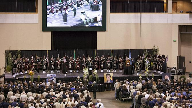 Pipe band plays on stage during a memorial for U.S. Forest Service firefighters Zbyszewski, Zajac, and Wheeler, who died fighting the Okanogan Complex fire, in Wenatchee, Washington