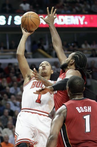 Boozer scores 19, Bulls beat Heat 96-86 in OT