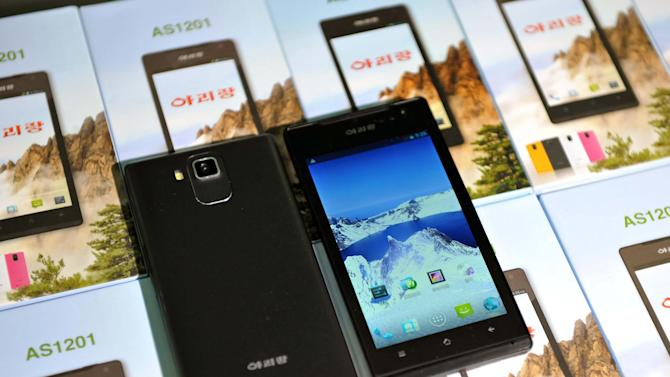 This undated photo released on Aug.10, 2013, by the Korean Central News Agency (KCNA) and distributed Aug. 11, 2013 by the Korea News Service, shows North Korean Arirang smartphone. North Korea's announcement that it is mass producing a home-grown smartphone has been met with skepticism in the tech industry. (AP Photo/KCNA via KNS) JAPAN OUT UNTIL 14 DAYS AFTER THE DAY OF TRANSMISSION