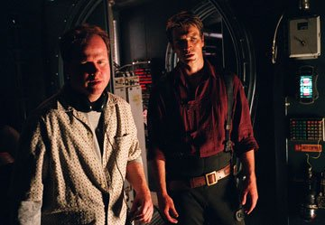 Writer/director Joss Whedon and Nathan Fillion on the set of Universal Pictures' Serenity