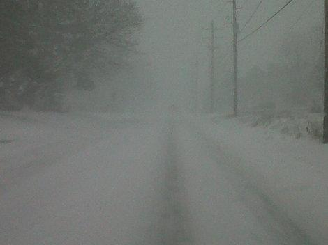 Photos: Snow Drapes Lake Erie Shoreline in Dangerous Blanket of Whiteouts, Icy Conditions