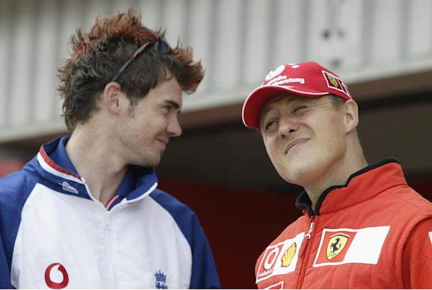 James Anderson chats to Michael Schumacher
