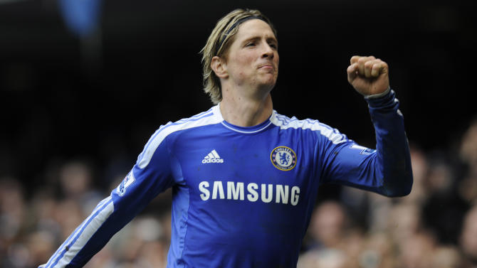 Chelsea's Fernando Torres celebrates his 3rd goal scored against Queens Park Rangers during their English Premier League soccer match at the Stamford Bridge Stadium, London, Sunday, April 29, 2012. (AP Photo/Tom Hevezi)