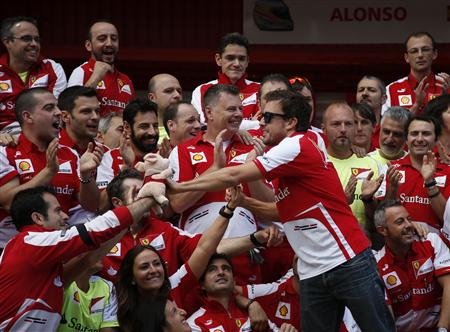 Ferrari Formula One driver Fernando Alonso of Spain celebrates with his team after the Spanish F1 Grand Prix at the Circuit de Catalunya in Montmelo