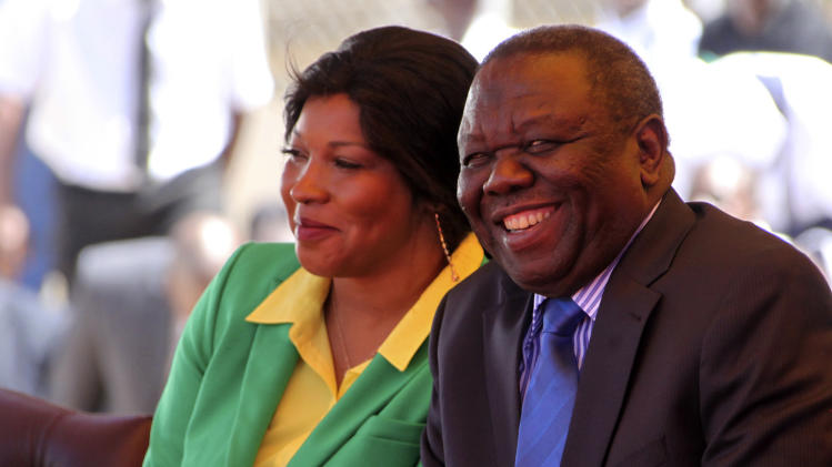 Zimbabwean Prime Minister Morgan Tsvangirai, right, and his wife Grace attend Zimbabwe's 33rd independence celebrations in Harare, Thursday, April 18, 2013. (AP Photo/Tsvangirayi Mukwazhi)
