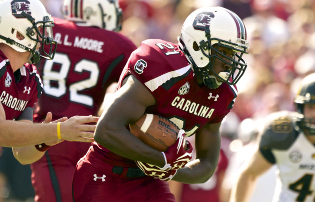 South Carolina running back Marcus Lattimore, looks for a hole in the Missouri defensive line as he rushes for a first down during the first half of an NCAA college football game, at Williams-Brice St