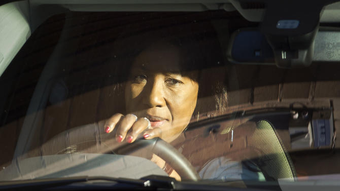 Makaziwe Mandela, one of the daughters of former South African president Nelson Mandela, leaves the Mediclinic Heart Hospital where Mandela is being treated in Pretoria, South Africa, Saturday, June 15, 2013. Relatives of Nelson Mandela have visited the former South African president in hospital where he is being treated for a lung infection. (AP Photo/Ben Curtis)