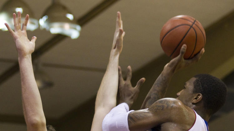 Duke forward Ryan Kelly (34) attempts to block a shot by Kansas forward Thomas Robinson, right in the first half of an NCAA college basketball game Wednesday, Nov. 23, 2011, in Lahaina, Hawaii. (AP Photo/Eugene Tanner)