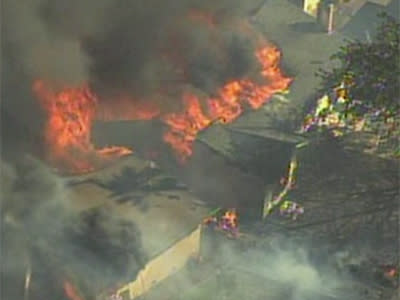 Raw: Fast-Moving Grass Fire Burns Calif. Homes
