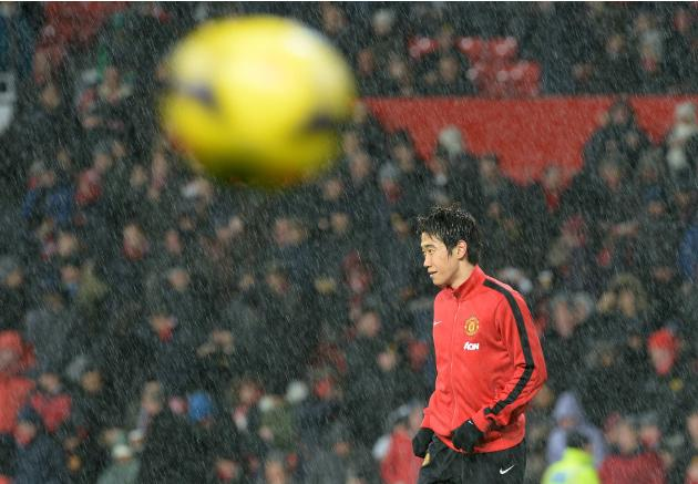 Manchester United's Shinji Kagawa warms up ahead of their English Premier League soccer match against Tottenham Hotspur at Old Trafford