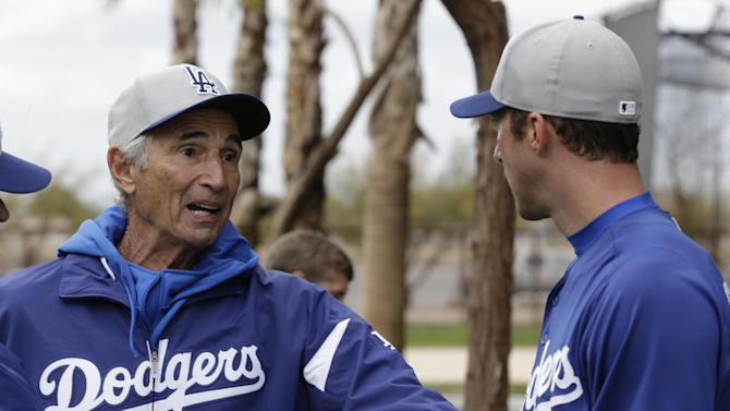 Los Angeles Dodgers Hall of Fame pitcher Sandy Koufax, left, talks with pitcher Chris Capuano during spring training baseball in Phoenix, Wednesday, Feb. 20, 2013.  (AP Photo/Paul Sancya)
