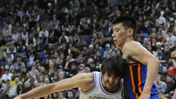 New York Knicks' Jeremy Lin, right, defends as Minnesota Timberwolves' Ricky Rubio, of Spain, drives into him in the first half of an NBA basketball game on Saturday, Feb. 11, 2012, in Minneapolis. The Timberwolves wore throwback uniforms from the 1967 Minnesota Muskies team. (AP Photo/Jim Mone)