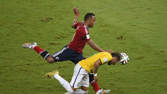 Colombia's Juan Zuniga (left) challenges Brazil's Neymar during the World Cup quarter-final match at the Castelao Stadium in Fortaleza, on July 4, 2014