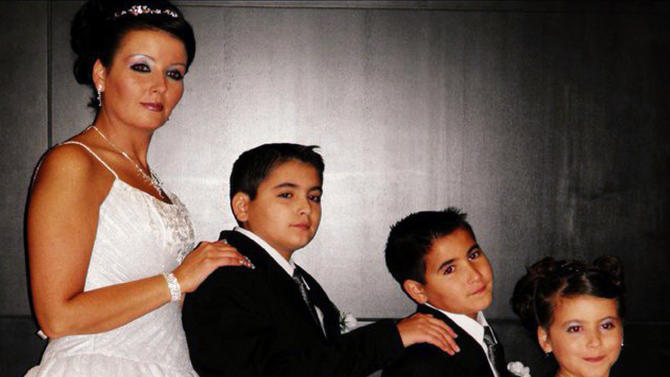 This undated photo provided May 1, 2012, by Leanna Flaitz shows Bethany Gonzales with her three children, 13-year-old Jehed, 10-year-old, Edhem, and 9-year-old Jannah, that her divorced Palestinian husband took to Gaza in February  where his family lives. Ahmed Abuhamda, Bethany's divorced husband, was charged last week in a federal criminal complaint with intent to avoid prosecution on three state felony counts filed April 10, 2012, charging him with aggravated interference with parental custody. (AP Photo/Lenna Flaitz Photography)