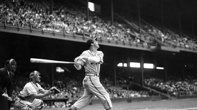 FILE - In this May 22, 1946 file photo, St. Louis Cardinals' Stan Musial bats against the Philadelphia Phillies during a baseball game at Shibe Park in Philadelphia. Musial, one of baseball's greatest hitters and a Hall of Famer with the Cardinals for more than two decades, died Saturday, Jan 19, 2013. He was 92. (AP Photo/Warren M. Winterbottom, File)