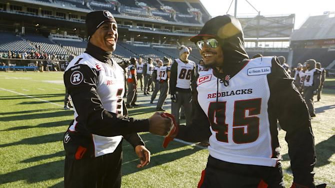 Redblacks Burris shakes hands with Munoz during their team's walkthrough practice ahead of the CFL 103rd Grey Cup championship football game in Winnipeg