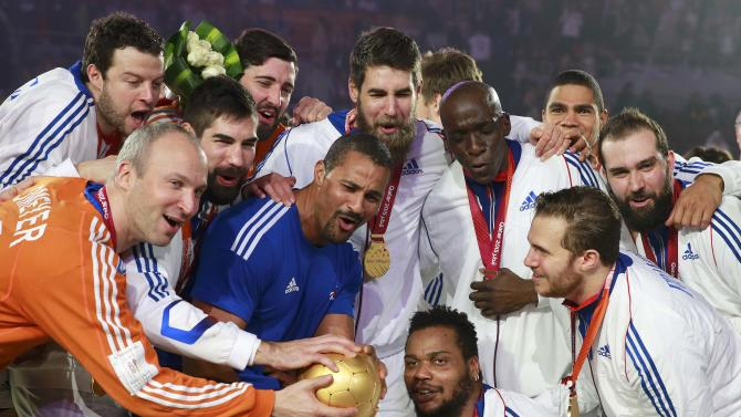 France's players celebrate with the trophy during the award ceremony for the 24th Men's Handball World Championship in Doha