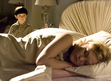 Seamus Davey-Fitzpatrick as Damien and Julia Stiles as Katherine in 20th Century Fox's The Omen