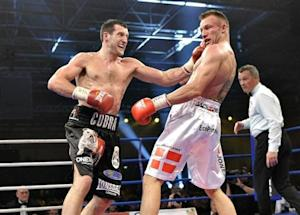 Carl Froch of Britain punches Mikkel Kessler of Denmark during their super-middle weight bout in Herning
