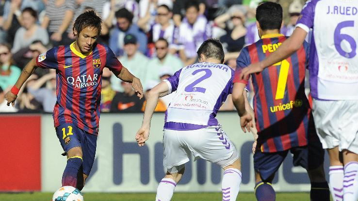 Barcelona's Neymar, left, runs with the ball during a Spanish La Liga soccer match at the Jose Zorrilla stadium in Valladolid, Spain, Saturday March 8, 2014