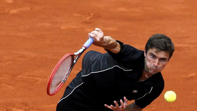 Gilles Simon of France plays a shot to compatriot Nicolas Mahut during their men's singles match at the French Open tennis tournament at the Roland Garros stadium in Paris