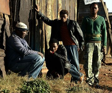 Kenneth Nkosi as Aap, Presley Chweneyagae as Tsotsi, Zenzo Ngqobe as Butcher and Mothusi Magano as Boston in Miramax's Tsotsi