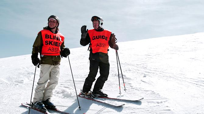 In this photo taken March 29, 2013, blind skier Wally Mozdzierz, left, takes a break at Colorado's Winter Park resort with his guide, Joe Ferrick. The American Blind Skiing Foundation, a Chicago-based nonprofit, brought Mozdzierz and others to Winter Park and plans another trip to Steamboat Springs this season..(AP Photo/Thomas Peipert)