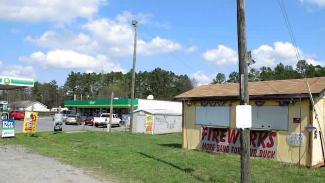 A fireworks stand is shuttered at the Lake Wylie Minimart in Lake Wylie, S.C. on Wednesday, March 21, 2012. The stand may have to stay closed because the store's owner thought his business was in South Carolina, but surveyors have determined it is actually in North Carolina, meaning his gas prices will likely go up 30 cents and he can't sell fireworks. (AP Photo/Jeffrey Collins)