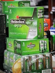 Soxes of Dutch beer Heineken are pictured at a convenience store in Singapore. Shareholders in the parent company of the Singapore-based brewer that makes Tiger Beer approved its takeover by Heineken on Friday, increasing the Dutch giant&#39;s footprint in the growing Asian market