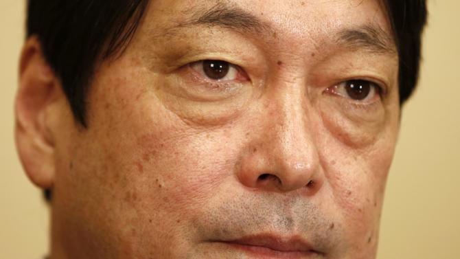 Japan's Defence Minister Itsunori Onodera listens to a question during an interview with Reuters in Tokyo