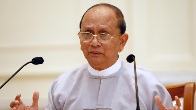 Myanmar President Thein Sein talks during a press conference at Presidential House in Naypyitaw, Myanmar, Sunday, Oct. 21, 2012. In a display of confidence and transparency, Myanmar's reformist president held his first press conference, breaking with the closed-mouth tradition of the previous military regime. (AP Photo/Khin Maung Win)