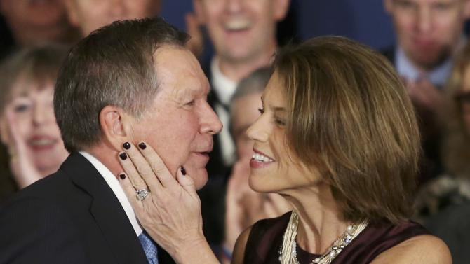 Republican U.S. presidential candidate John Kasich reacts with his wife Karen at his 2016 New Hampshire presidential primary night rally in Concord