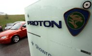 File photo of a Malaysian car maker Proton showroom in Kuala Lumpur. Previous negotiations to sell stakes in Proton to Volkswagen and General Motors fell apart because of the Malaysian government&#39;s desire to keep the company domestically-owned