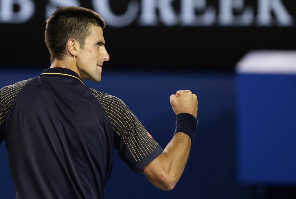 Serbia's Novak Djokovic reacts during his fourth round match against Switzerland's Stanislas Wawrinka at the Australian Open tennis championship in Melbourne, Australia, Sunday, Jan. 20, 2013. (AP Photo/Andy Wong)