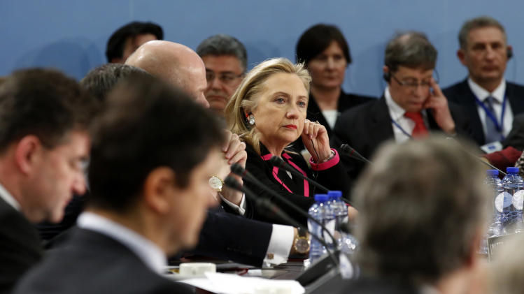 Secretary of State Hillary Rodham Clinton listens during the North Atlantic Council (NAC) meeting at NATO headquarters in Brussels, Tuesday, Dec. 4, 2012.    (AP Photo/Kevin Lamarque, Pool)