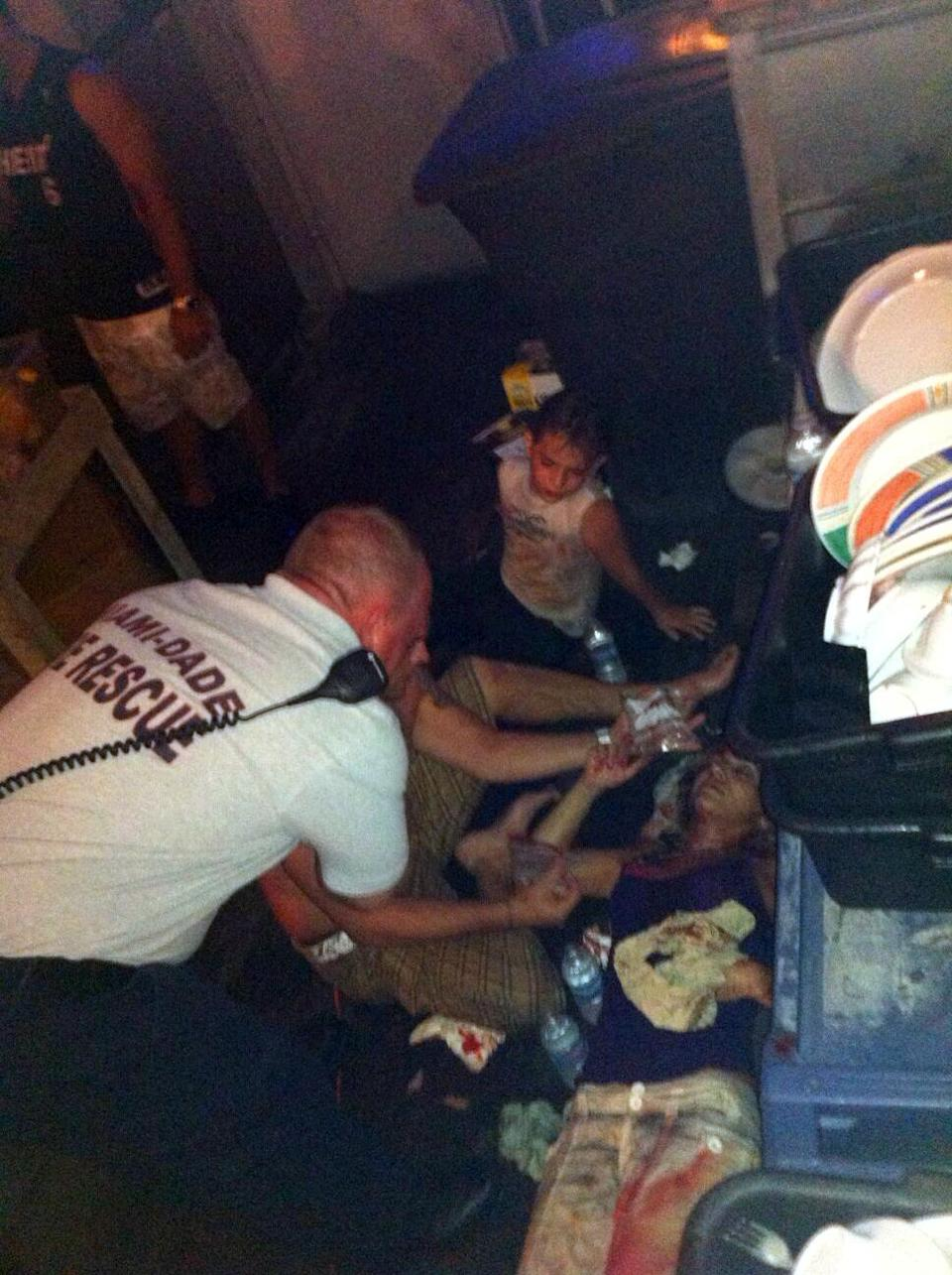 In this photo provided by WSVN-TV, victims of a deck collapse  at Shuckers Bar & Grill in Miami are treated by Miami-Dade first responders Thursday night, June 13, 2013.  The deck collapsed during the NBA Finals on Thursday night, sending dozens of patrons into the shallow waters of Biscayne Bay. Three people were critically injured. (AP Photo/WSVN-TV, Tom Tuckwell) MANDATORY CREDIT