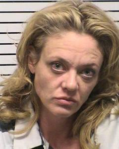 "This photo provided by Iredell County, NC, sheriff's department, Lisa Robin Kelly is shown. Kelly is free on bond after being arrested for assault. Police in the Charlotte, N.C., suburb of Mooresville arrested the 42-year-old Kelly and 61-year-old husband Robert Joseph Gilliam after responding to a disturbance at their home Monday, Nov. 26, 2012. Both are free on bond. Gilliam is charged with misdemeanor assault on a female. Kelly is charged with misdemeanor assault. They were taken to the Iredell County Detention Center and released on $500 bond apiece. They have a court date of Jan. 25. It's not known if either has an attorney. Kelly portrayed Laurie Forman, sister of Topher Grace's lead character Eric, on the FOX series, which ended in 2006. She also appeared on the TV shows ""Murphy Brown"" and ""Married . . . With Children."" (AP Photo/Iredell County, NC, sheriff's department)"