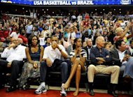 This file photo shows US President Barack Obama with his wife Michelle, daughter Malia, and Vice President Joe Biden, as the US Senior Men's National Team and Brazil play during a pre-Olympic exhibition basketball game at the Verizon Center, on July 16, in Washington, DC