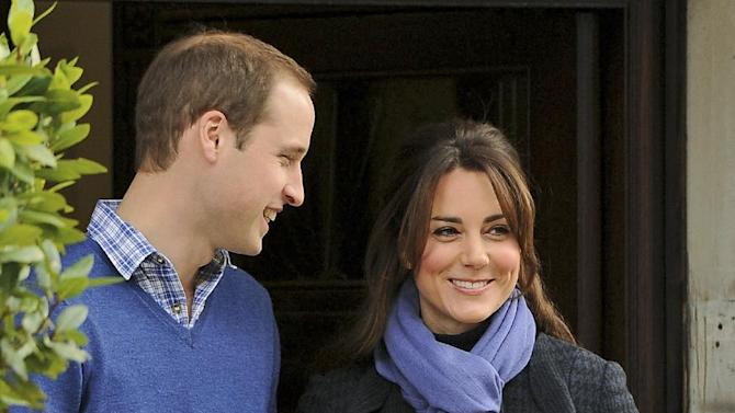Britain's Prince William stands next to his wife Kate, Duchess of Cambridge as she leaves the King Edward VII hospital in central London, Thursday, Dec. 6, 2012. Prince William and his wife Kate are expecting their first child, and the Duchess of Cambridge has been admitted to hospital suffering from a severe form of morning sickness in the early stages of her pregnancy.  (AP Photo/Andrew Matthews, PA)